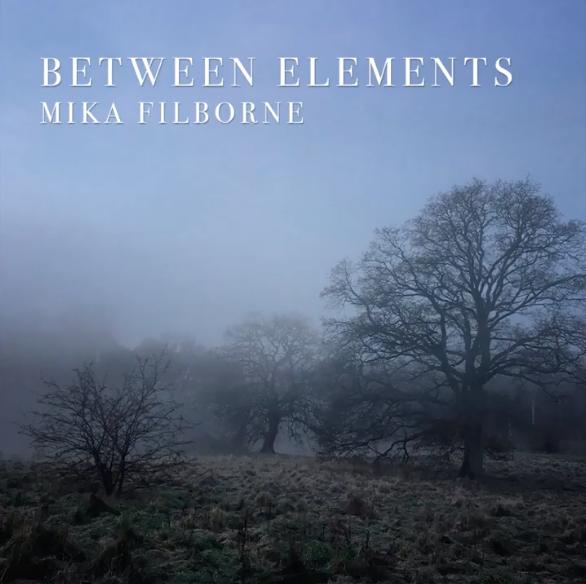 Cover til Between Elements af Mika filborne - forestiller en skov i tåge